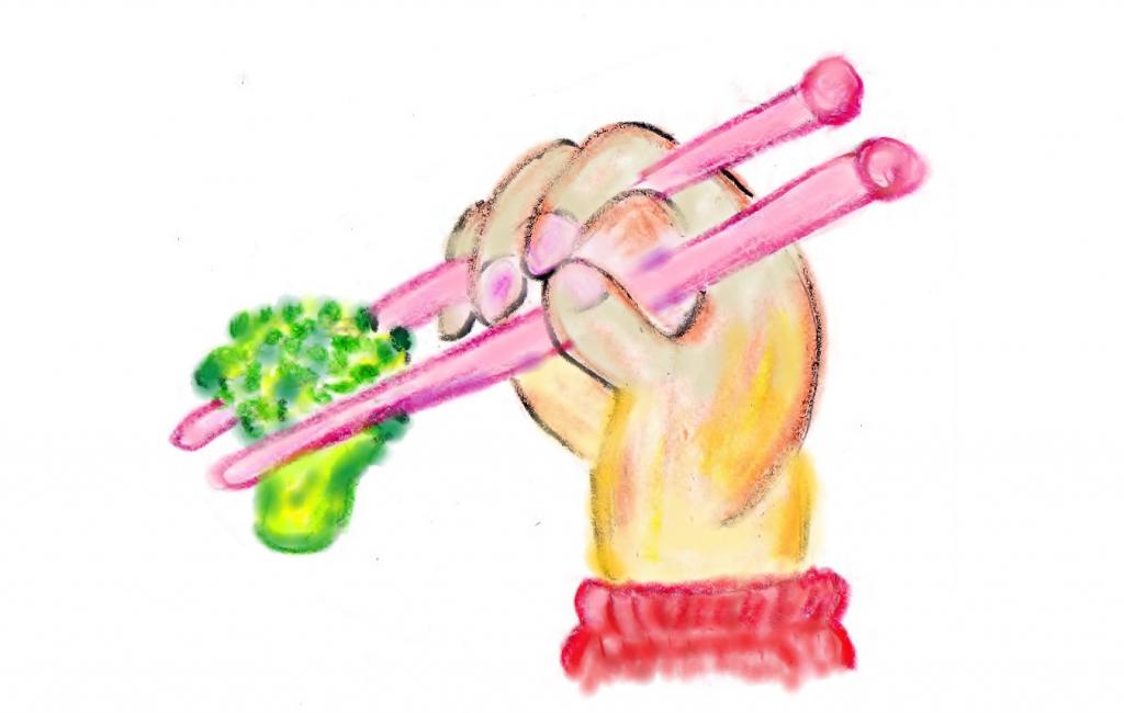 ブロッコリーを箸でつまんでいる