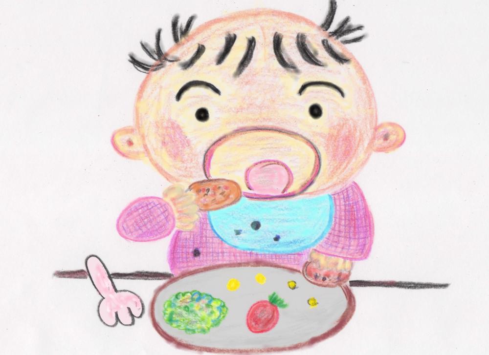 赤ちゃんが楽しく食事をしている様子